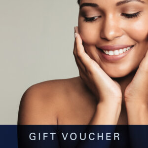 woman touching her face & smiling on a Gift Voucher