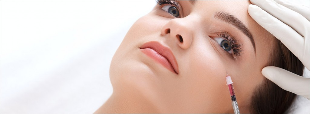 image of lady face having an injectable treatment under the eye